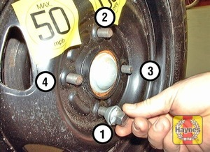 Illustration of step:  Locate the spare wheel on the studs and tighten the nuts moderately with the wheel brace - Changing the wheel - step 8