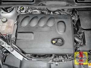 Illustration of step: The oil filter is located under the engine cover - step 1
