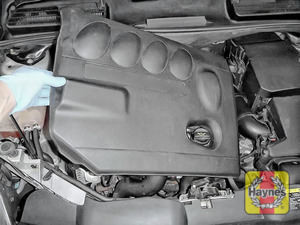 Illustration of step: Carefully release the engine cover and relocate away from the engine compartment - step 2