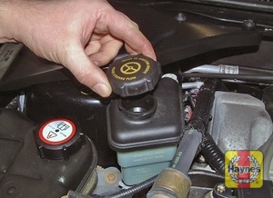 Illustration of step:  If topping-up is required, wipe clean the area around the reservoir filler neck and unscrew the filler cap from the reservoir - Safety first! - step 41