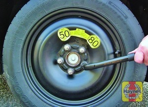 Illustration of step:  Fit the spare wheel, and screw on the nuts - Changing the wheel - step 8