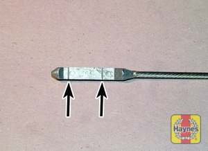 Illustration of step:  Note the level on the end of the dipstick, which should be between the upper (MAX) mark and lower (MIN) mark - Car care - step 14