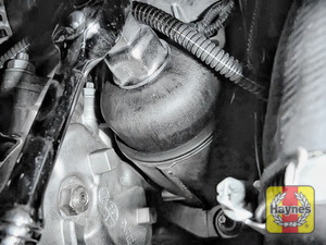 Illustration of step: Fit a 27mm filter wrench socket securely onto the oil filter housing - step 3