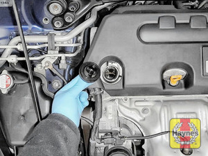 Illustration of step: To open the oil filler cap turn anti-clockwise  - step 5