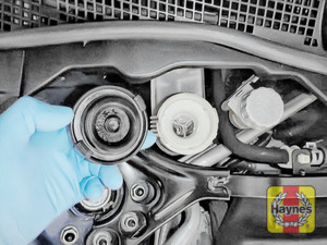 Illustration of step: If the level needs topping up - WEARING GLOVES - carefully open the cap and have a paper towel ready to catch any drips, as brake fluid is corrosive - step 4