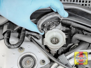 Illustration of step: If the level needs topping up - WEARING GLOVES - carefully open the cap, have a paper towel ready to catch any drips as brake fluid is corrosive! - step 4