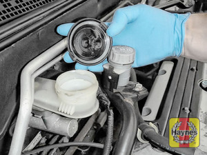 Illustration of step: If the level needs topping up - WEARING GLOVES - carefully open the cap, and have a paper towel ready to catch any drips as brake fluid is corrosive - step 4