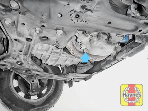 Illustration of step: The sump plug is located on the base of the engine and accessed from underneath the car - step 1