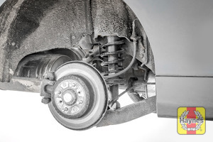 Illustration of step: Take a good look around the brake system aningd the suspension arm, check for any leaks - step 12