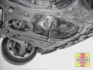 Illustration of step: With an oil catchment tray in position, use a 17mm spanner or socket to carefully remove the sump plug and fully drain the oil - step 6