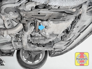 Illustration of step: The sump plug is located on the base of the engine and is accessed underneath the car - step 1