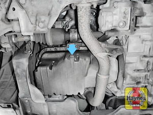 Illustration of step: The sump plug is located on the base of the engine, and it is accessed from underneath the car - step 1