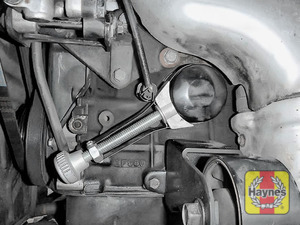 Illustration of step: Using an oil filter wrench, unscrew the filter anti-clockwise and remove the old oil filter - step 5
