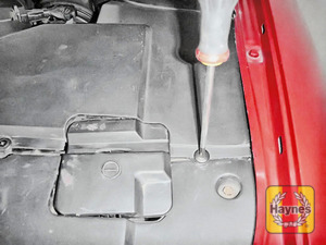 Illustration of step: Undo cover retaining fixings - use a phillips screwdriver and a 10mm socket to do this - step 2