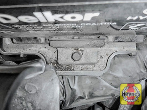 Illustration of step: Check battery is generally secure, and if loose, tighten the battery retainer - step 5