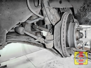 Illustration of step: Now quickly check all the brake pipes for condition, check for any leaks, and inspect the rubber gaitors for integrity - step 8