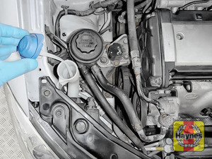 Illustration of step: Open the filler cap, and note the built in dipstick to determine fluid level - step 2