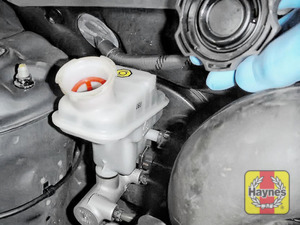 Illustration of step: If the level needs topping up - WEARING GLOVES - carefully open the cap, and have a paper towel ready to catch any drips as brake fluid is corrosive! Now securely replace and tighten the cap - step 4