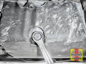 Illustration of step: With a oil catchment tray in position, Using a 17mm spanner or socket, carefully remove the sump plug and fully drain the oil - step 6
