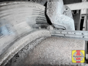 Illustration of step: Using a ruler, measure the approximate thickness of the remaining wear material on the brake pad - step 7