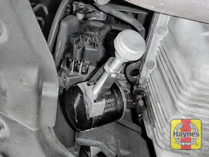Illustration of step: Using a oil filter wrench, unscrew the filter anticlockwise and remove the old oil filter - step 3