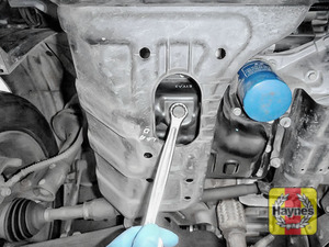 Illustration of step: With an oil catchment tray in position, use a 17mm spanner or socket to carefully remove the sump plug and fully drain the oil - step 3