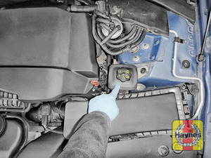 Illustration of step: The power steering fluid reservoir is located here - step 1