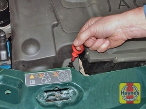 Illustration of step:  Withdraw the dipstick (see Underbonnet check points above for exact location) - Car care - step 6