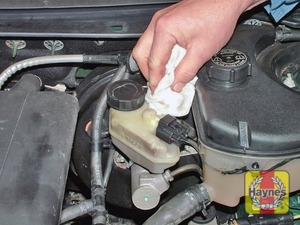 Illustration of step:  Unscrew the filler cap and lift it out of position, holding the wiring connector plug and taking care not to damage the level sender float - Safety first! - step 27