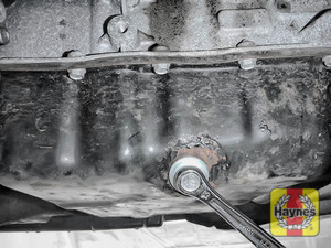 Illustration of step: With an oil catchment tray in position, use a 13mm spanner or socket to carefully remove the sump plug and fully drain the oil - step 4