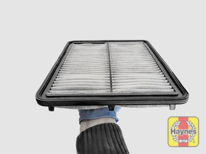 Illustration of step: Clean off any debris on the surface of the filter - step 10
