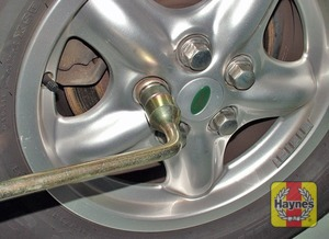 Illustration of step:  Securely tighten the wheel nuts then refit the wheel trim/hub cap (as applicable) - Changing the wheel - step 11