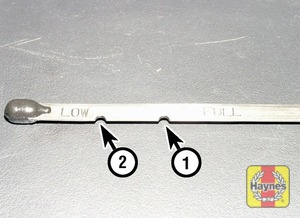 Illustration of step:  Note the oil level on the end of the dipstick, which should be between the upper full mark (1) and low minimum mark (2) - Car care - step 11
