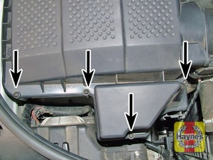 Illustration of step:  The air filter cover is secured by 4 screws at the front edge (arrowed) …  - step 2