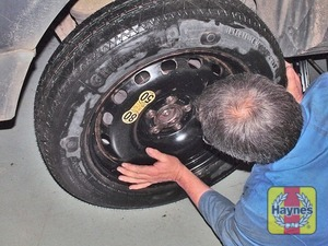 Illustration of step:  Fit the spare wheel and screw on the wheel nuts - Changing the wheel - step 10