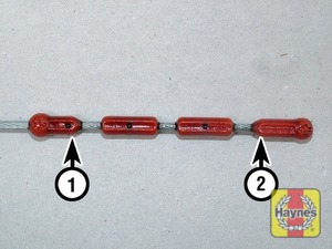 Illustration of step:  Note the oil level on the end of the dipstick, which should be between the upper full mark (1) and low minimum mark(2) - Car care - step 11