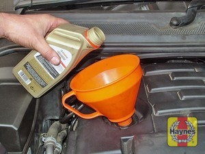 Illustration of step:  Add the oil slowly, checking the level on the dipstick often - Car care - step 13