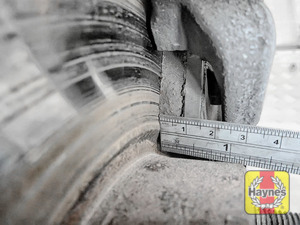 Illustration of step: Using a ruler, measure the approximate thickness of the remaining wear material on the brake pad - step 5