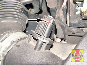 Illustration of step:  Slide up the locking clip, and disconnect the mass air flow sensor wiring plug  - step 2