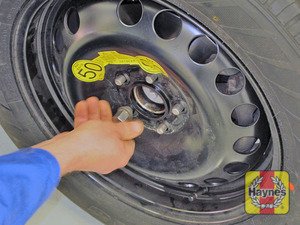 Illustration of step:  Fit and tighten the wheel retaining nuts  - step 18