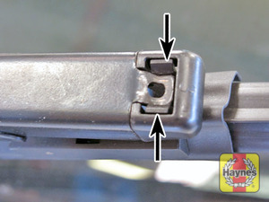 Illustration of step:  Depress the clips and pivot the blade away - Front wiper blades - step 3