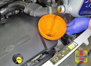 Illustration of step:  Use a funnel to help reduce spillage - The correct oil - step 15
