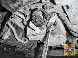 Illustration of step: With an oil catchment tray in position, use a 13mm spanner or socket to carefully remove the sump plug and fully drain the oil - step 6