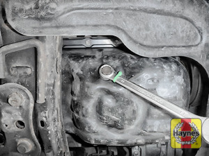 Illustration of step: With an oil catchment tray in position, use a 14mm spanner or socket to carefully remove the sump plug and fully drain the oil - step 4