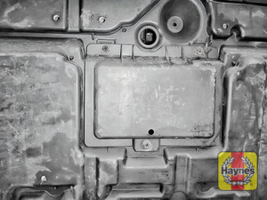Illustration of step: The location of oil filter is at the base of the engine, beneath this access cover - step 1