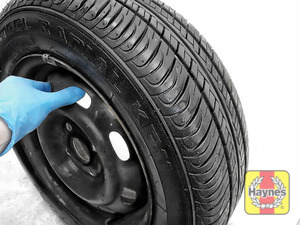 Illustration of step: Before refitting the wheels, take a look at the tyre tread, there is a UK legal requirement to have a minimum of 1 - step 12