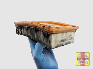 Illustration of step: Clean off any debris on the surface of the filter - step 7