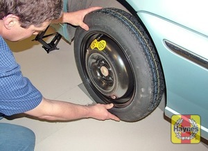 Illustration of step: Fit the spare wheel, refit the wheel bolts, and tighten moderately with the wheelbrace - step 7