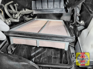 Illustration of step: Lift out the air filter, clean off any debris on the surface of the filter - step 4