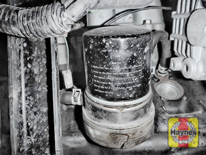 Illustration of step: Using a oil filter wrench, unscrew the filter anticlockwise and remove the old oil filter - step 2